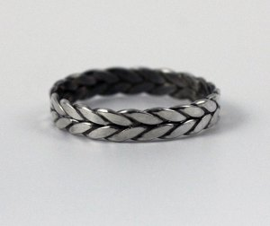 Ring with braided appearance.