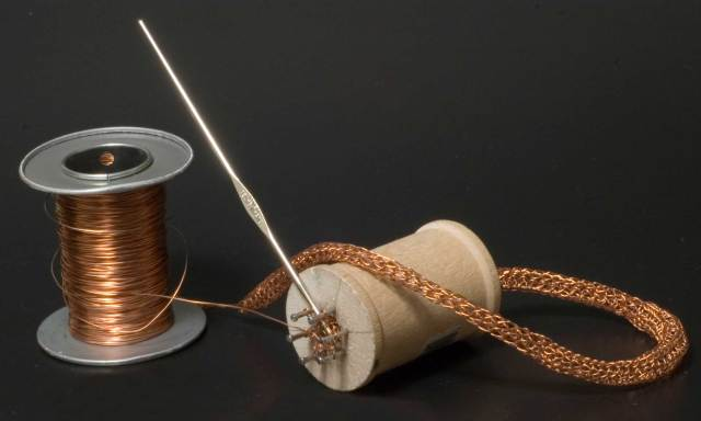 Knitting copper wire with a knitting spool and steel crochet hook.