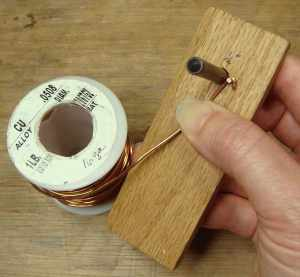 Setting up for winding a wire coil.
